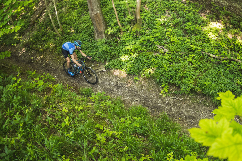 Kinesis Tripster AT on woodland singletrack